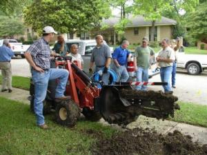 the Danville Irrigation Repair Team with their trusty trencher